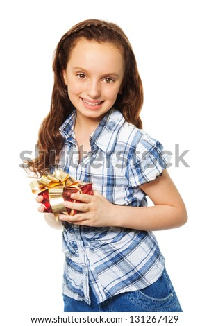 Small Teen happy teen caucasian girl holding small red present box with gold