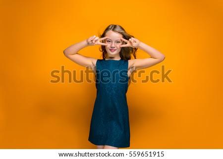 Happy teen girl - Shutterstock ID 559651915