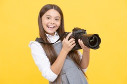 happy teen girl photographer use digital photo camera, photographing.
