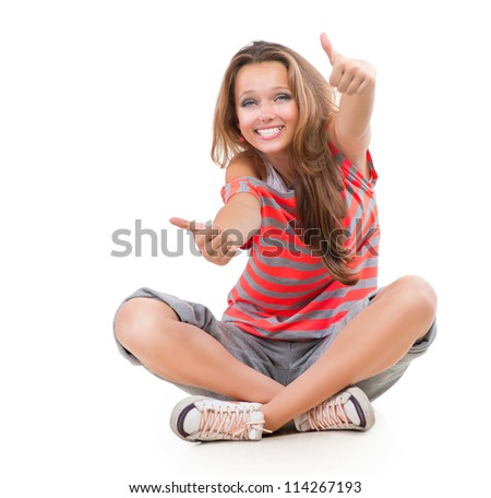 Happy Teen Girl showing Thumbs up isolated one white. Full length Portrait. Teenager