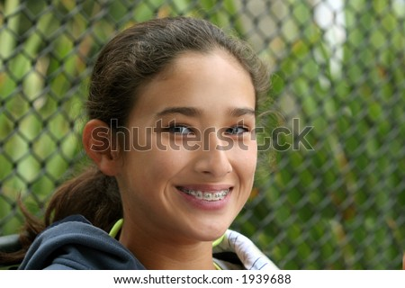 Happy teen girl with braces - stock photo