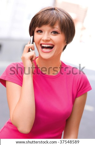 happy teen girl with mobile phone