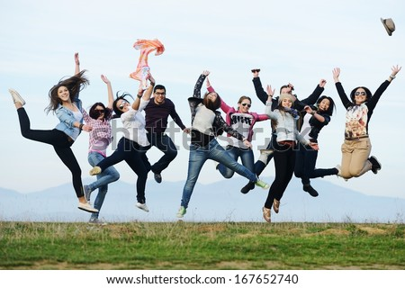 Happy teen girls having good fun time outdoors jumping up in air #167652740