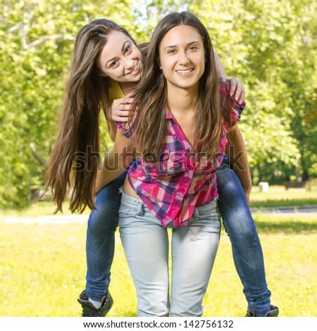 Happy teenage girl having fun in the park.