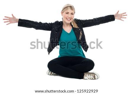 Happy teenage girl stretching both hands sideways. It's hug time.