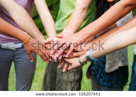 Happy Teenage Group with Hands on Stack