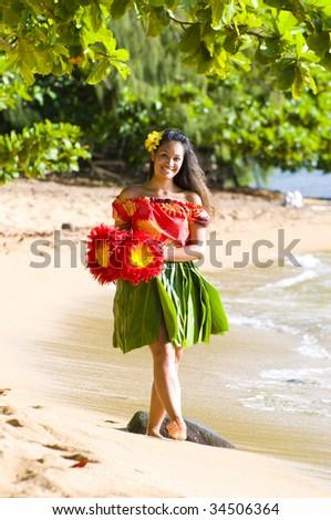 happy teenage hula girl walking on the beach in Kauai Hawaii