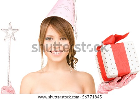 happy teenage party girl with magic wand and gift box