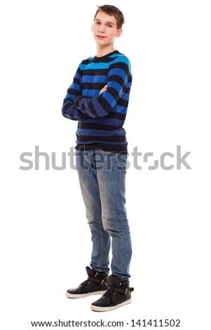 Happy teenager boy in casual standing isolated over white background