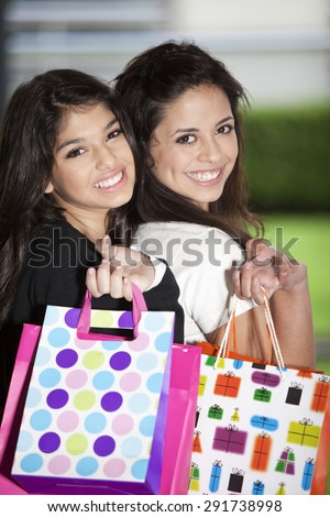 Happy teenager girls with shopping bags