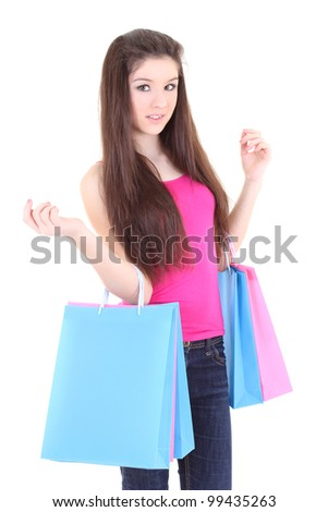 Happy teenager in pink t-shirt with shopping bags over white