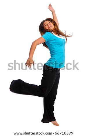 Happy teenager jumping in studio, isolated on white