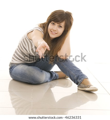 happy teenager sitting on the floor isolated on white background