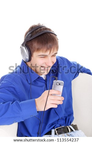 happy teenager with mobile phone in a chair on the white background