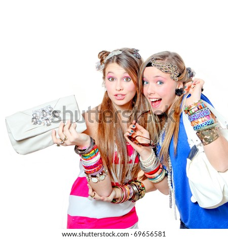 Happy teenagers Fashion girls wearing funky accessories whilst shopping