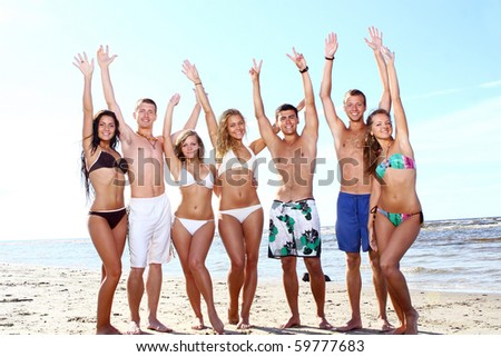 happy teenagers playing in the sea