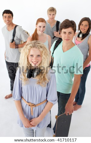 Happy teenagers smiling at the camera agaisnt white background with bags