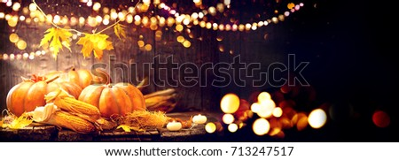 Happy Thanksgiving Day background, wooden table decorated with Pumpkins, Corncob, Candles and garland. Halloween. Beautiful Holiday Autumn festival concept scene Fall, Harvest #713247517