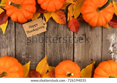 Happy Thanksgiving Gift Tag With Double Border Of Pumpkins And Autumn Leaves Over A Rustic Wood
