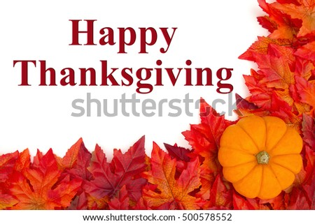 Happy Thanksgiving greeting, Some fall leaves and a pumpkin with text Happy Thanksgiving #500578552
