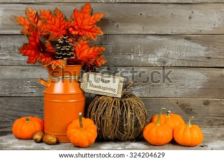Happy Thanksgiving tag, pumpkins and autumn home decor with rustic wood background
