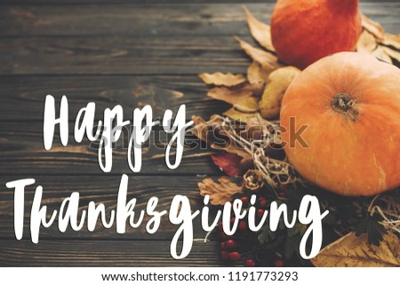 Happy Thanksgiving Text on beautiful composition of Pumpkin, autumn vegetables with colorful leaves,acorns,nuts, berries on wooden rustic table. Seasons greeting card #1191773293