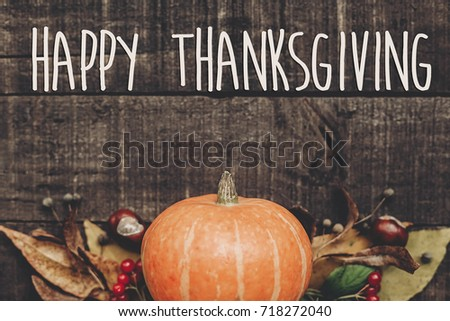 happy thanksgiving text sign, greeting card. fall image flat lay. beautiful pumpkin and leaves and berries on rustic wooden background, top view. cozy autumn mood. fall holiday - Shutterstock ID 718272040