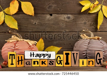 Happy Thanksgiving Wood Sign With Cloth Pumpkins And Leaves Against A Rustic Wooden Background 725446450