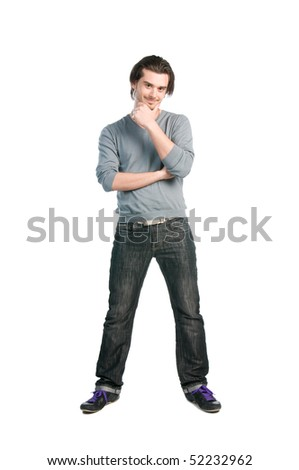Happy thinking young man with positive expression standing full length isolated on white background