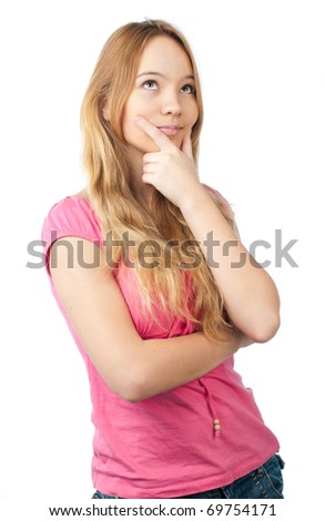 happy thoughtful teenage girl with hand under her chin looking up isolated on white background