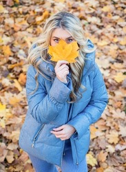 Happy to be around. female beauty and style. woman with long hair in fall forest with leaves. girl on dry fallen leaves background. wear warm clothes. cozy and comfortable. autumn season fashion