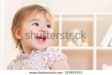 Happy toddler girl with a great big smile