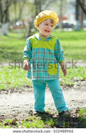 Happy toddler on grass in spring