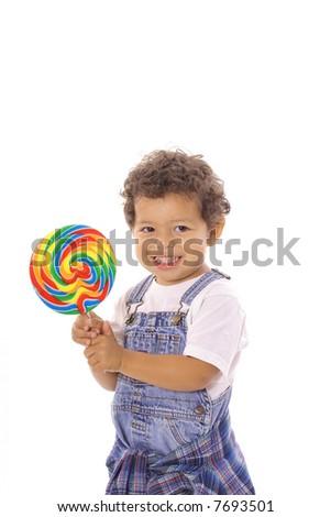 happy toddler with big lollipop