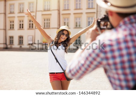 Happy tourist girl posing for photo