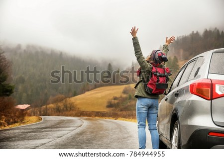 Happy tourist travelling in countryside #784944955