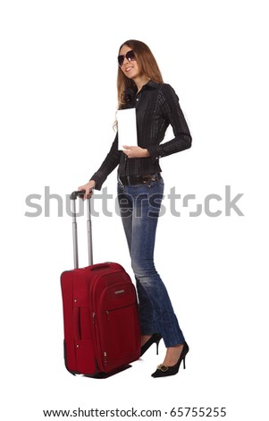 Happy tourist woman with a red suitcase. She holds the white form (blank) for your text