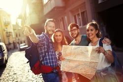 Happy tourists exploring travel destination city
