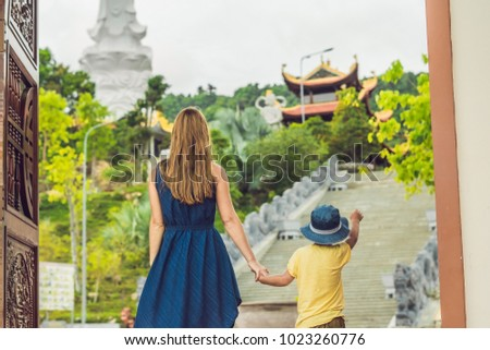 Happy tourists mom and son in Pagoda. Travel to Asia concept. Traveling with a baby concept.