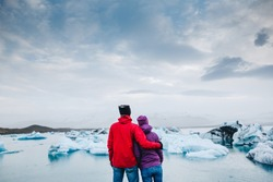 Happy travel couple enjoying the view on Iceland Jokulsarlon glacial lagoon