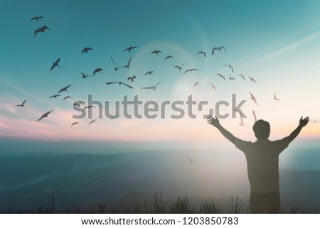 Happy travel man rise hand on morning view. Christian inspire praise God on good friday background. Now one man self confidence on peak enjoying nature the sun concept world wisdom fun hope