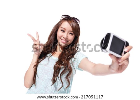Happy travel young girl selfie taking pictures of herself isolated over white background, asian