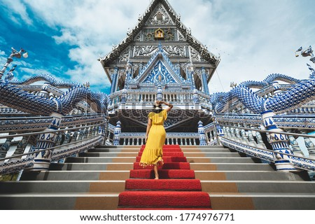 Happy traveler asian woman with dress travel in Wat Pak Nam Khaem Nu temple, Chanthaburi, Thailand Foto stock ©
