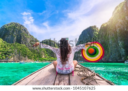 Happy traveler woman in summer dress joy fun relaxing on boat, Maya beach, Phi Phi island, Tourism Phuket, Krabi, Travel Thailand, Beautiful destination Asia, Summer holiday outdoor vacation trip
