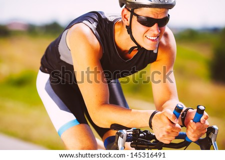 Happy triathlete cycling on a bicycle