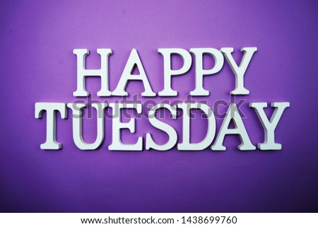 Happy Tuesday wooden letter alphabet on purple background #1438699760