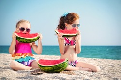 Happy two children of the sea with watermelon