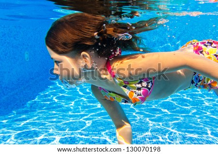 Happy Underwater Child In Swimming Pool Beautiful Girl Swims And Having Fun Kids Sport On