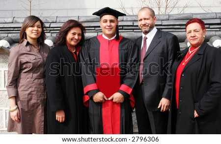 Happy university graduate with his family.