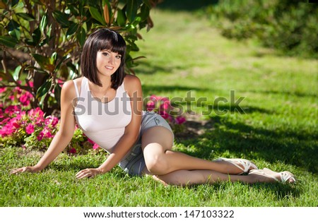 Happy vacation woman summer girl smiling and resting on nature. Beautiful woman outdoors. Sexy summer girl. Trendy summer woman.